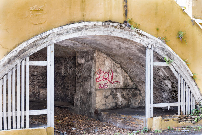Underground storage area near steps. In Christiansted St. Croix in disrepair and abandoned royalty free stock photos