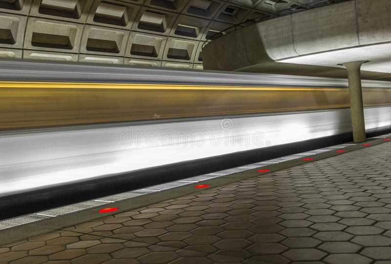Underground train station in the DC metro. With moving train stock photography