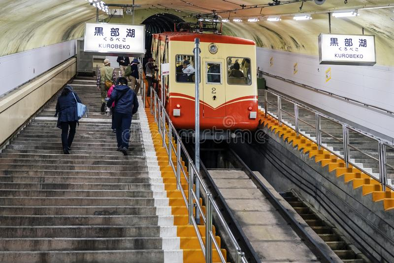 Underground Tram On Steep Slope And People Climbing Up In The Tunnel stock photography
