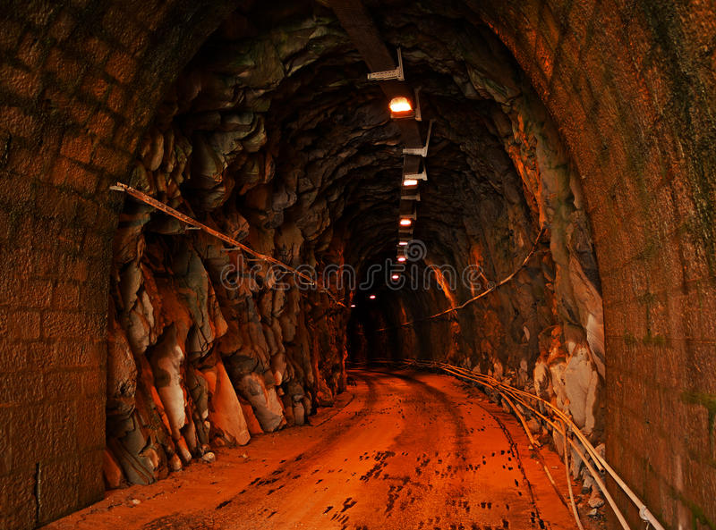 Underground tunnel with lighting - marble quarry stock images