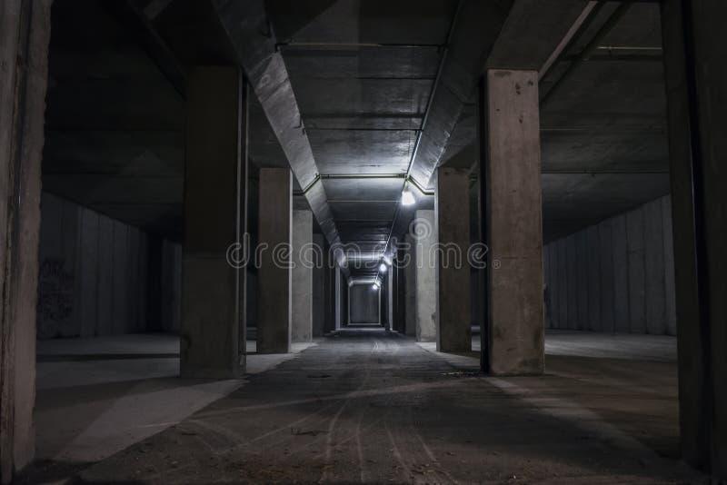 Underground tunnel into mountain. Dark, underground tunnel leading into mountain defence hall royalty free stock photos