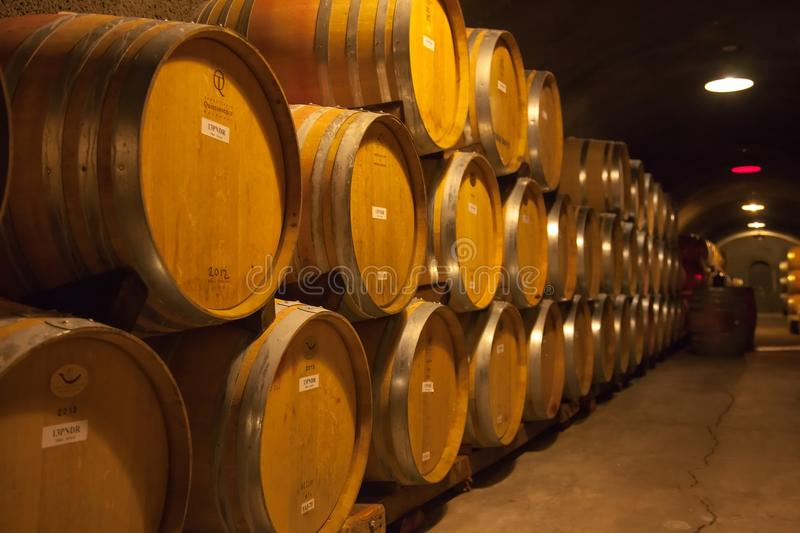 Underground wine cask storage. Hundreds of oak casks from France and America line the wine caves that lie below many wineries in California's wine country royalty free stock photography