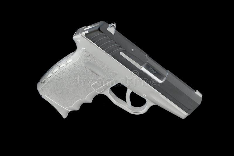 Underkompakt handeldvapen som isoleras på en svart bakgrund royaltyfria foton