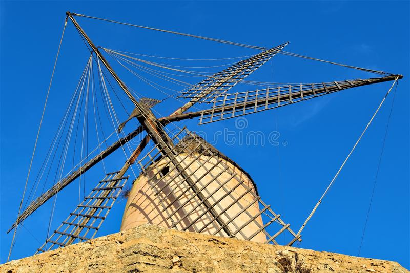 Underneath a Majorca Windmill, at Santa Ponca, Majorca, Spain. A clear blue sky amd ambient lighting at dusk, helped to capture this well preserved traditional royalty free stock images