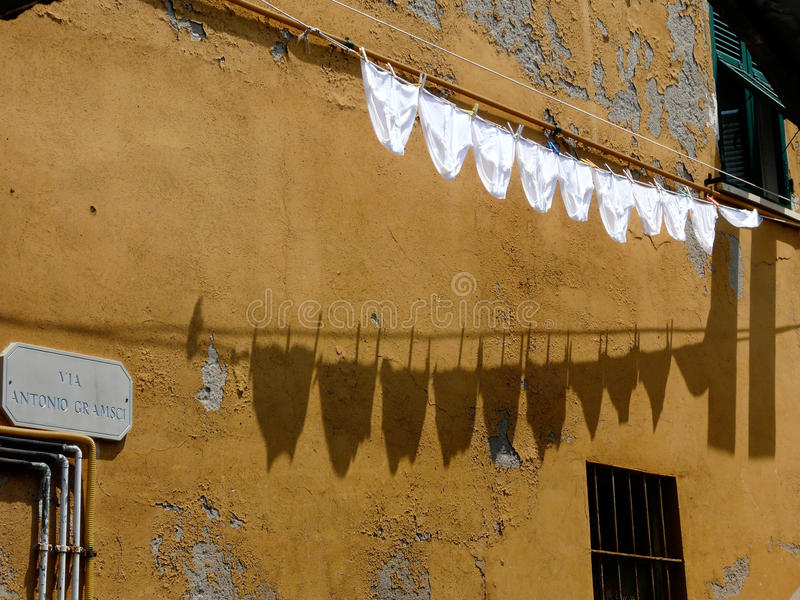 Underpants on washing line in Cinque Terre Italy. Ten white underpants hanging on traditional washing line in Cinque Terre Italy stock photos