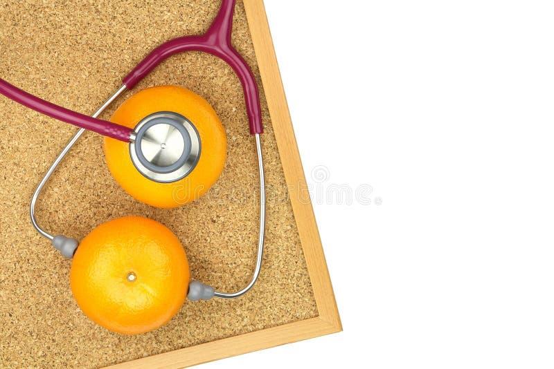 Undersökande apelsin för stetoskop på ett korkbräde Medicinsk utrustning, arkivbilder