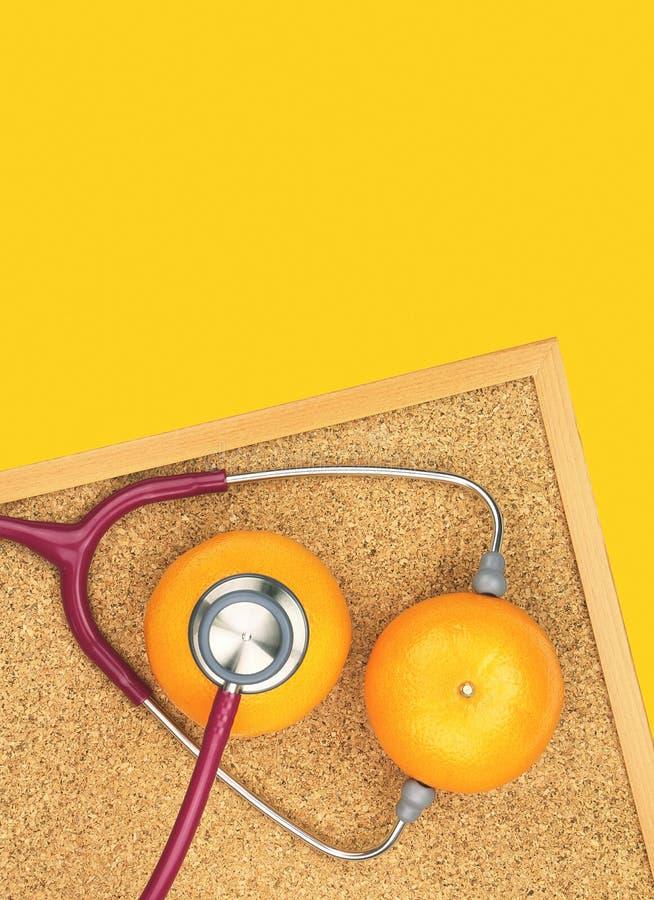 Undersökande apelsin för stetoskop på ett korkbräde Medicinsk utrustning, arkivfoto