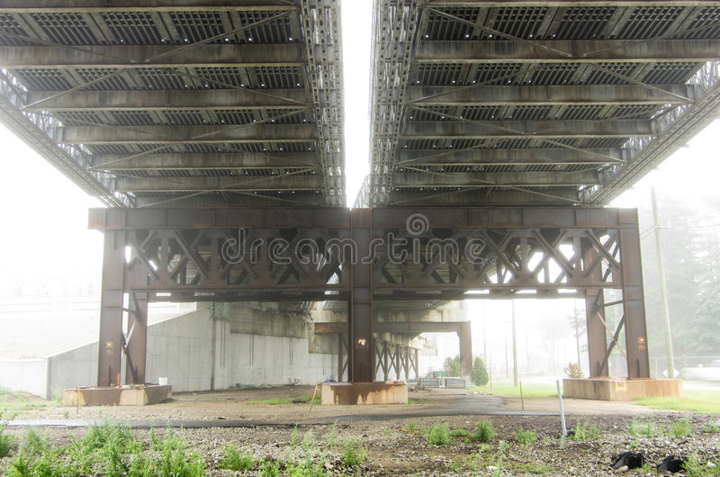 Underside of bridge in fog. The underside of the Fore River Bridge in Weymouth Ma is shrowded in fog royalty free stock images