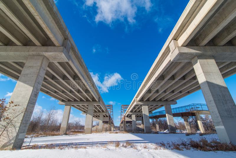 Underside state highway bridges that go over the Minnesota River south of the Twin Cities - great straight lines, symmetry, and bl royalty free stock images