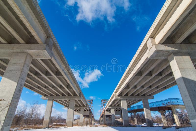 Underside state highway bridges that go over the Minnesota River south of the Twin Cities - great straight lines, symmetry, and bl royalty free stock photography