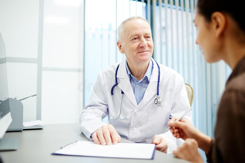Understanding kind doctor talking to patient royalty free stock images