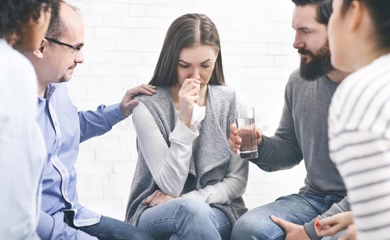 Understanding people giving support to crying woman stock photography