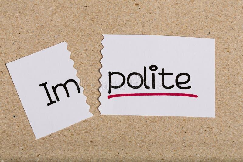 Underteckna med grovt för ord som vänds in i artigt arkivbild