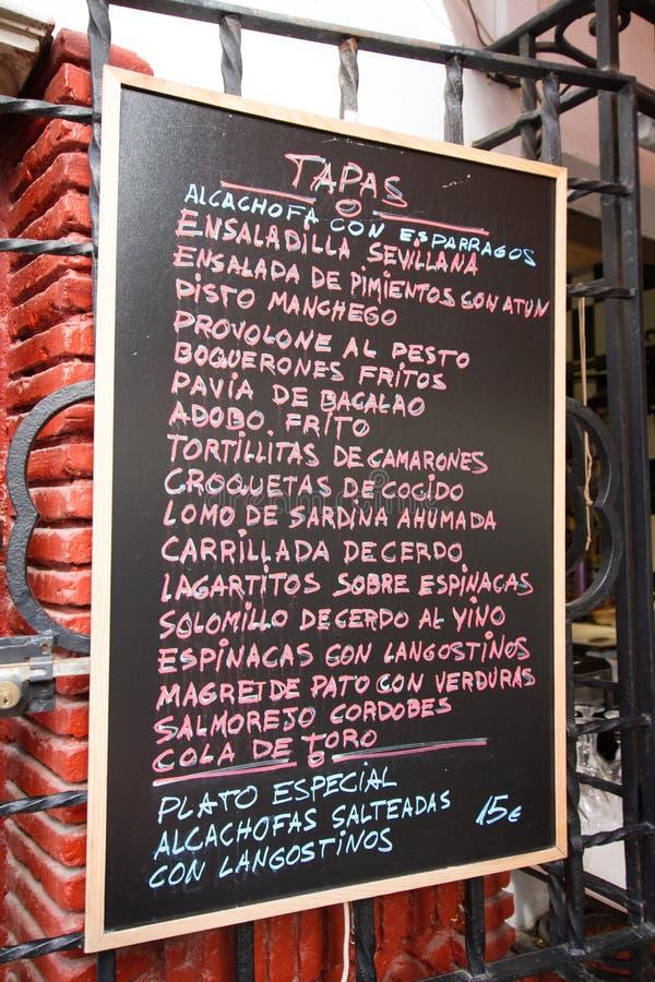 Underteckna reklamen Tapas i Sevilla, Spanien royaltyfri bild
