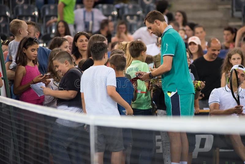 Undertecknande autografer för tennisspelare royaltyfria foton