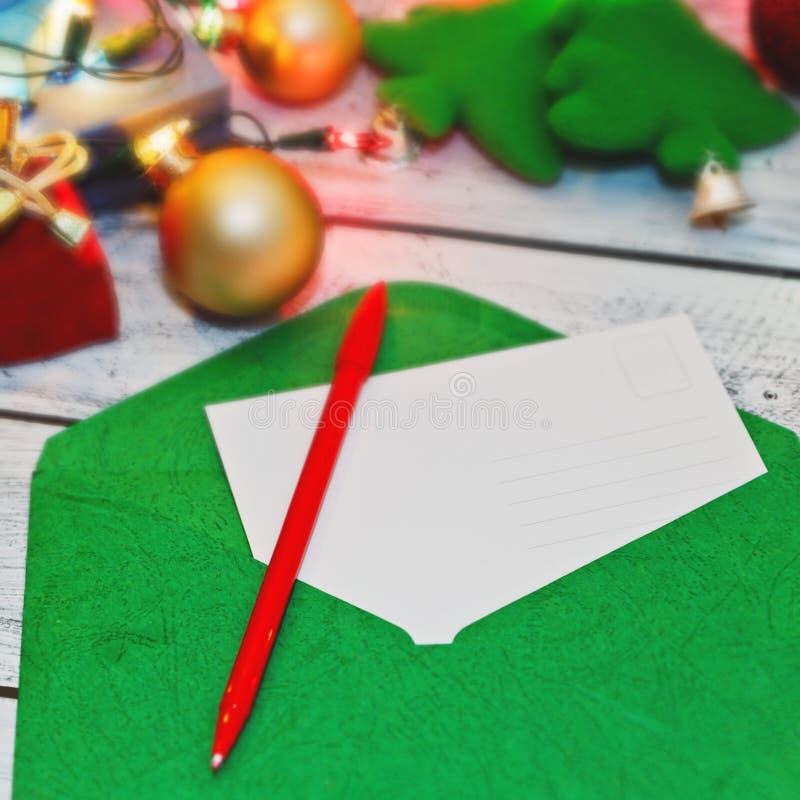 Underteckning för julhälsningsvykort arkivfoto