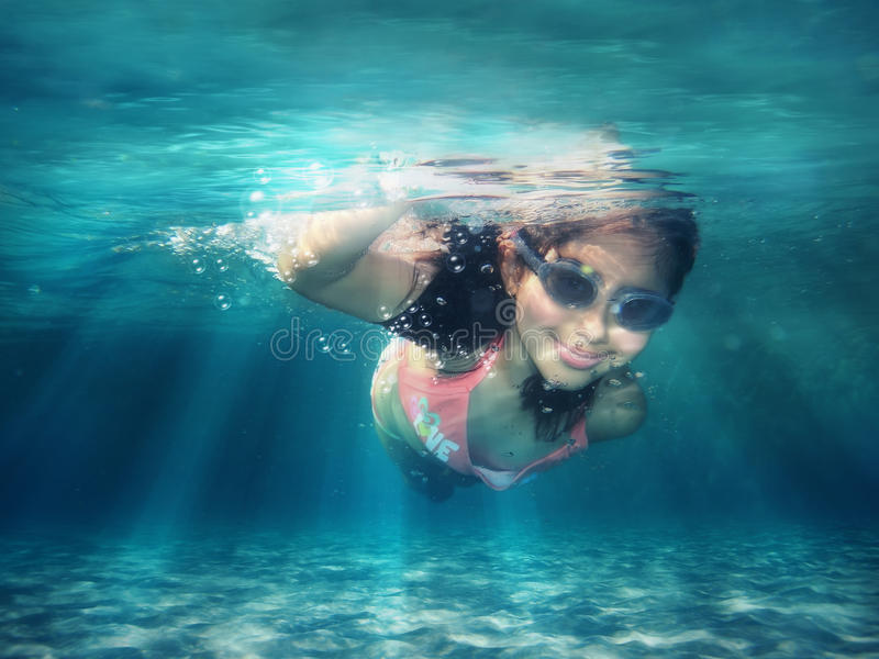 Underwater. Swimming along the sea floor stock photography