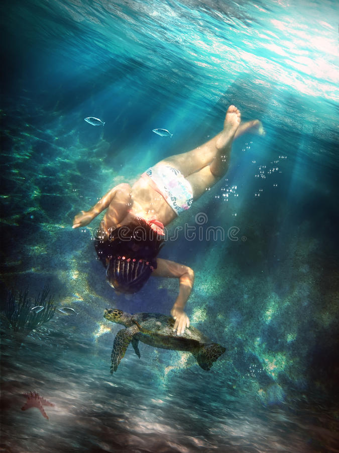 Underwater. Petting a turtle under the sea stock photo
