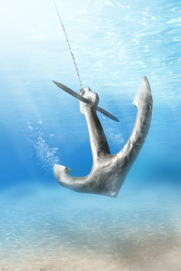 Underwater anchor stock photo