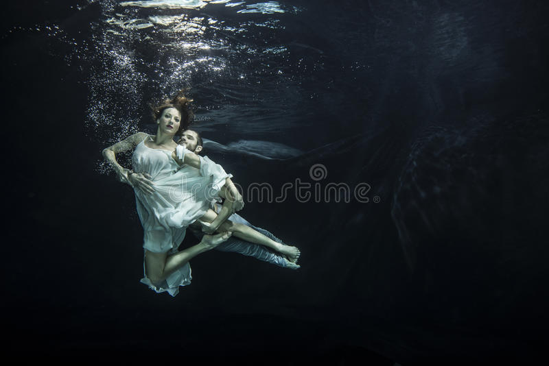 Underwater ballet dancers royalty free stock photos