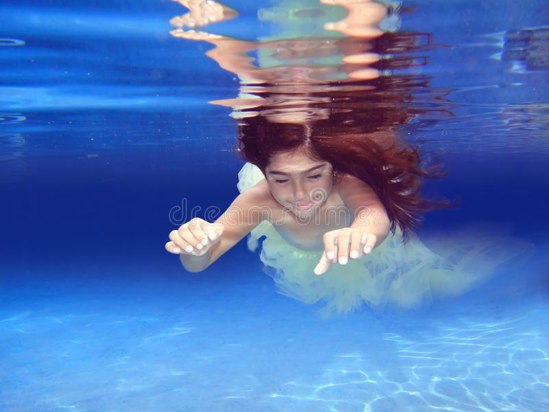 Underwater girl. Underwater image of a long hair girl floating stock photo