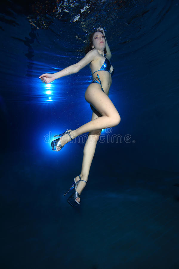 Underwater model. Posing in the pool royalty free stock photography
