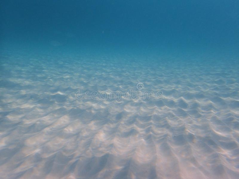 Underwater photo of artistic sand lines royalty free stock photography