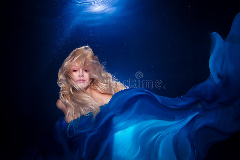 Underwater photo pretty young girl with blond long hair wearing stock photo