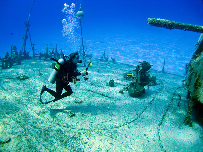 Underwater Photographer. Shooting the shipwreck Tibbits in Cayman Brac royalty free stock images