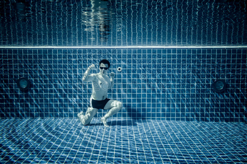 Underwater pool portraying Superman stock photography