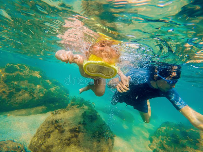 Underwater portrait of family snorkeling together at clear tropical ocean royalty free stock photos