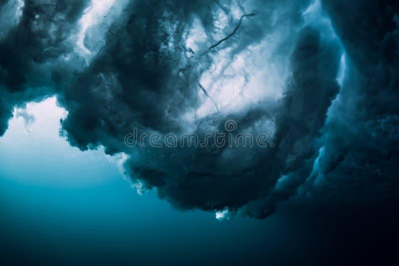 Underwater powerful wave. Barrel wave crashing in ocean royalty free stock images