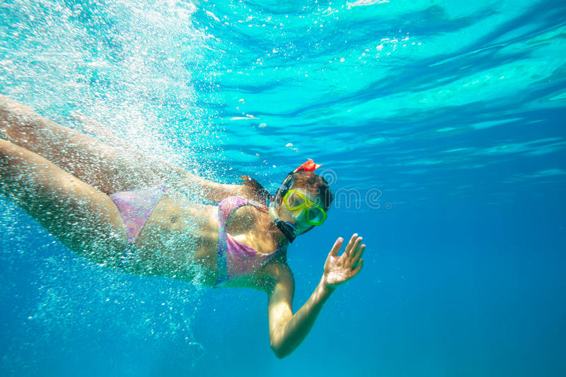 Underwater shoot of a young lady snorkeling stock image