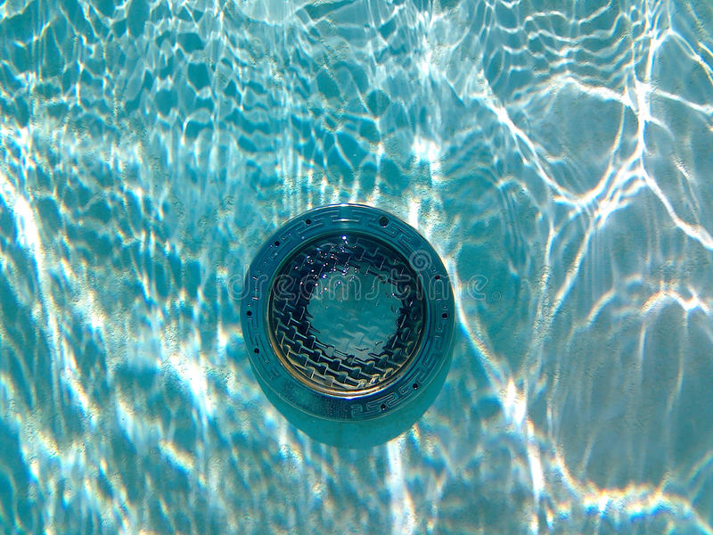 Underwater swimming pool light with sun reflections stock photography