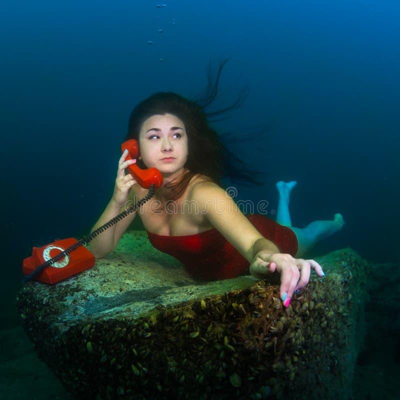 Underwater telephone call stock photo