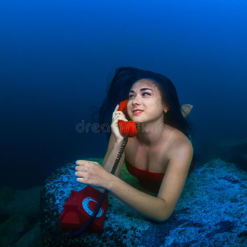 Underwater telephone call royalty free stock photos