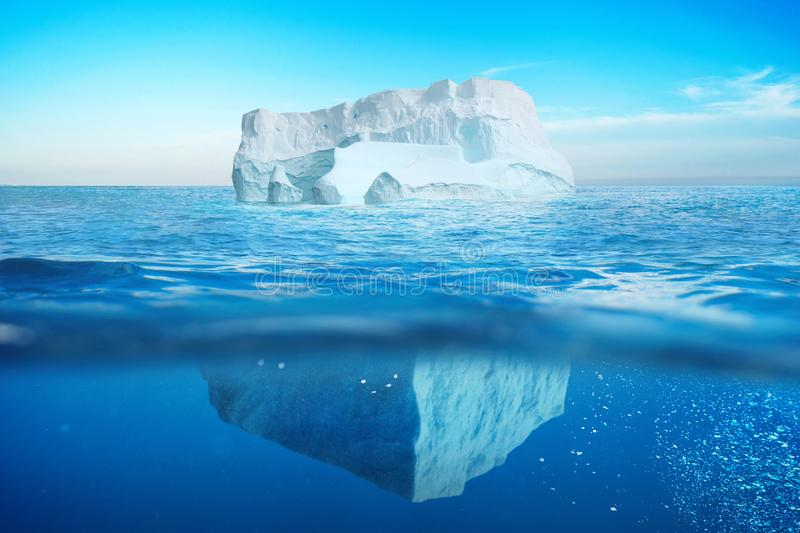 Underwater view of iceberg with beautiful transparent sea. royalty free stock images
