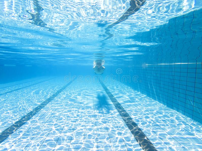 Underwater view of man in swimming pool stock photo