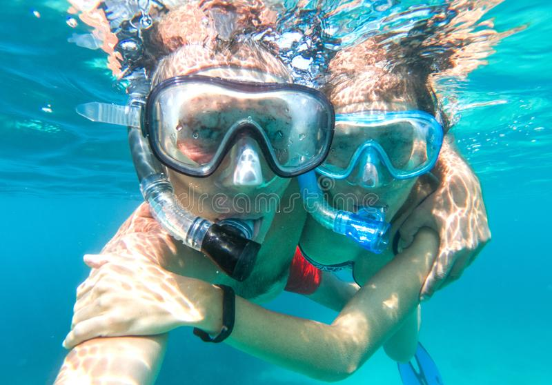 Underwater view of snorkeling couple in the sea stock image