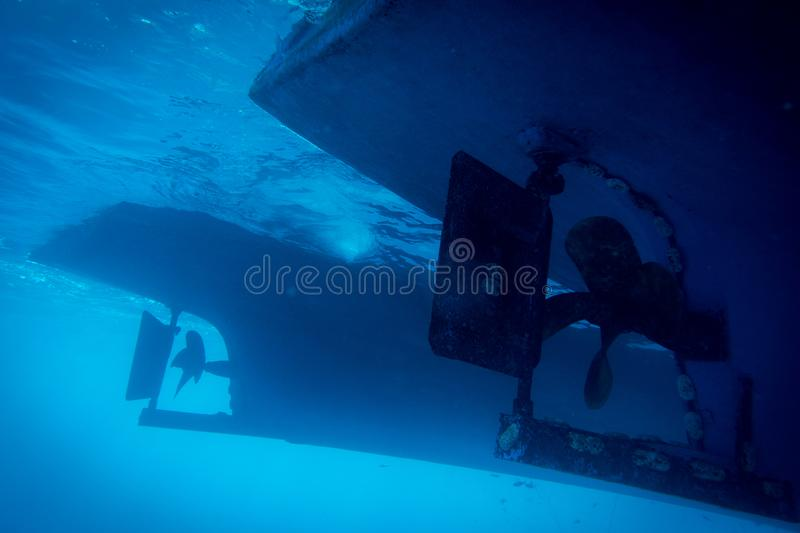 Underwater view to yacht rudder and prop royalty free stock photo
