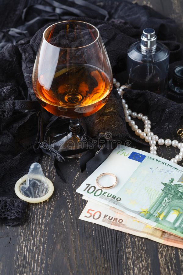 Underwear, cognac and money to symbolize the cost of sex royalty free stock photography