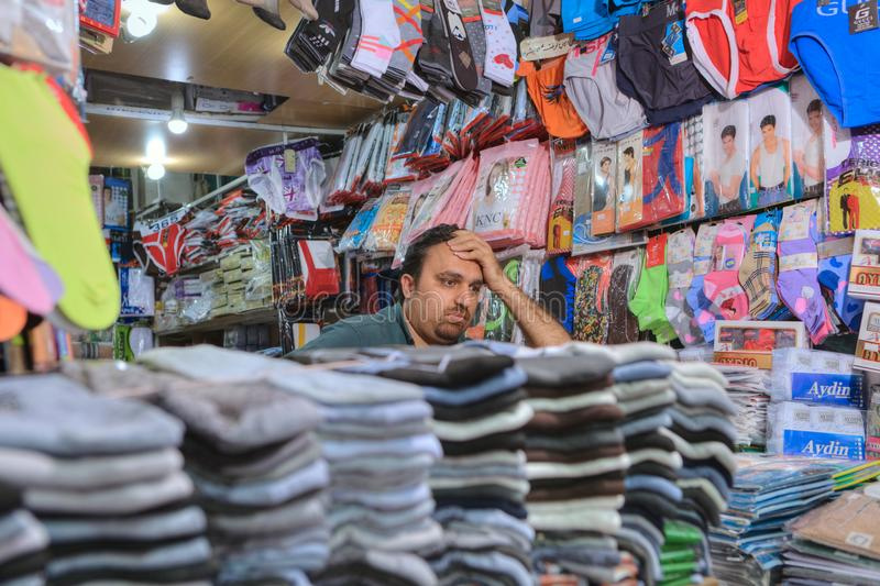 Underwear store inside bazaar, Iranian seller waiting for buyers royalty free stock images