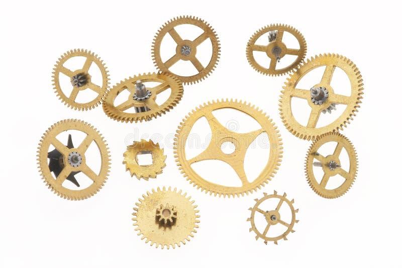 Undici vecchie piccole ruote dentate immagine stock