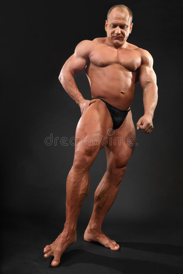 Download Undressed Bodybuilder Touches Floor By Toe Stock Image - Image: 24227477