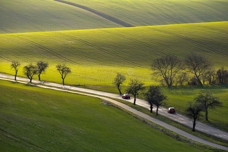 Undulating fields of South Moravia in the evening light. Traveling by car in spring undulating fields of South Moravia in the evening light royalty free stock image