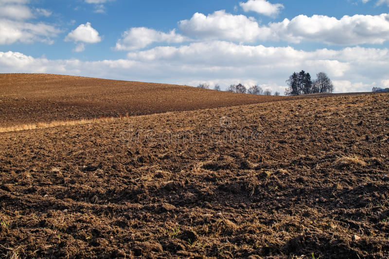 Download Undulating Plowed Field In Early Spring Stock Image - Image: 38648651