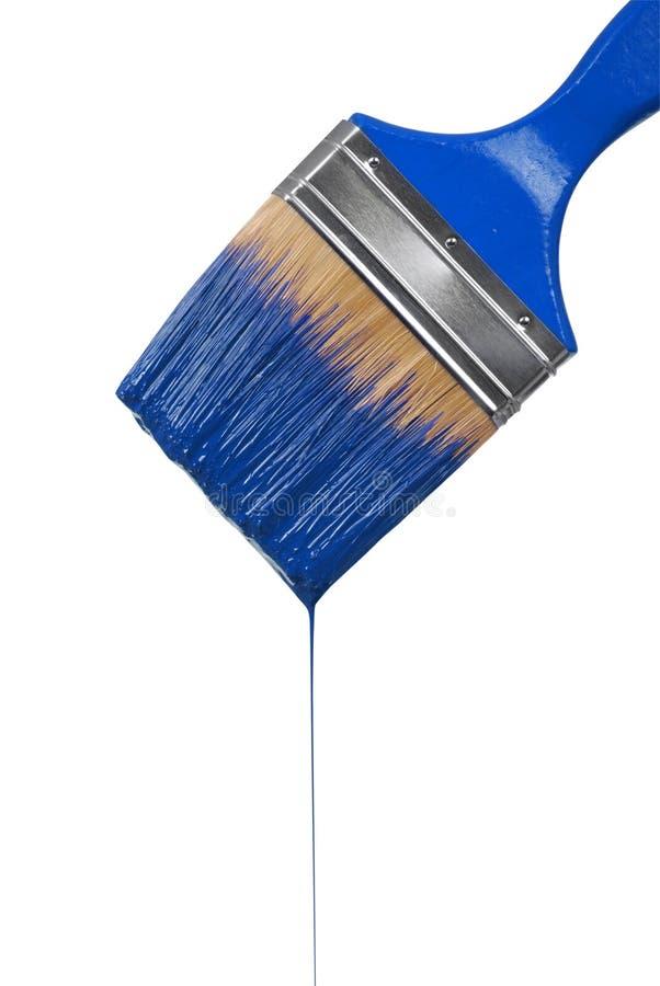 Une égoutture de pinceau avec la peinture bleue image stock