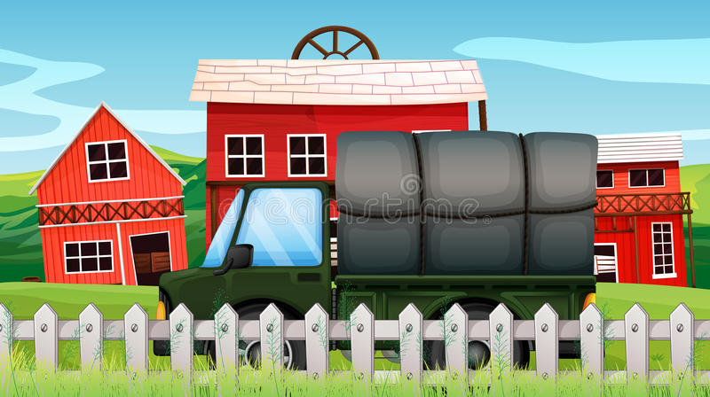Une cargaison verte devant une grange à l'intérieur de la barrière illustration libre de droits