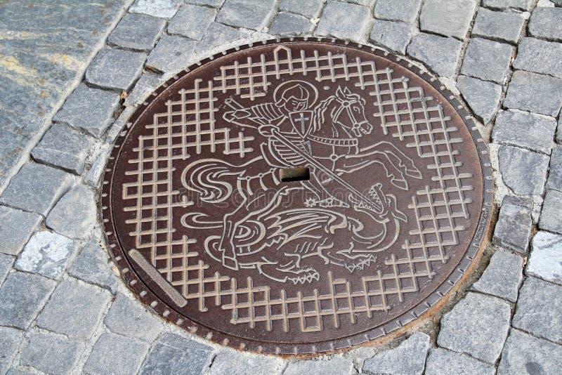 Une couverture de trou d'homme dans Chope en grès-être-rhein, Suisse photo stock