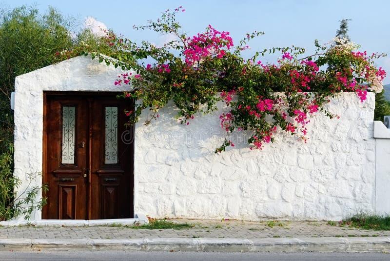 Une façade égéenne typique de stonehouse de style photographie stock libre de droits